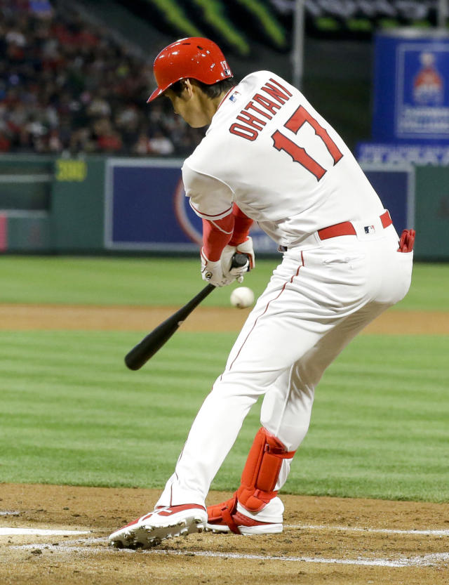 Los Angeles Angels' Shohei Ohtani of Japan, hits a single against the San Francisco Giants during the second inning of a baseball game in Anaheim, Calif., Friday, April 20, 2018. (AP Photo/Chris Carlson)