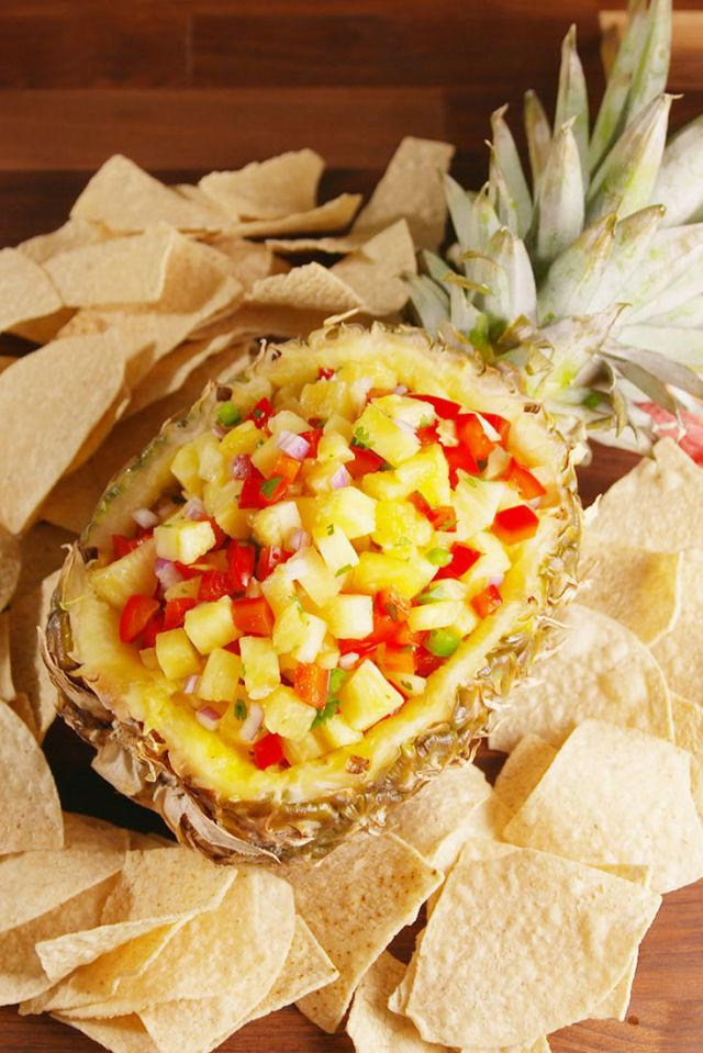 """<div>Summer BBQs just got fancy AF.</div><div>Get the recipe from <a rel=""""nofollow"""" href=""""http://www.delish.com/cooking/recipes/a53020/pineapple-salsa-in-pineapple-recipe/"""">Delish</a>.</div>"""