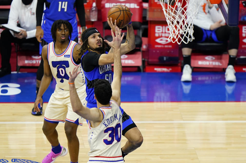 Orlando Magic's Cole Anthony (50) goes up for a shot against Philadelphia 76ers' Furkan Korkmaz (30) during the second half of an NBA basketball game, Sunday, May 16, 2021, in Philadelphia. (AP Photo/Matt Slocum)