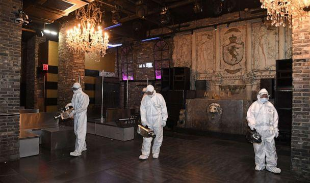 PHOTO: Quarantine workers spray disinfectant at a nightclub in the Itaewon district of Seoul, South Korea, on May 12, 2020, amid an outbreak of the novel coronavirus. (Yonhap/Reuters)