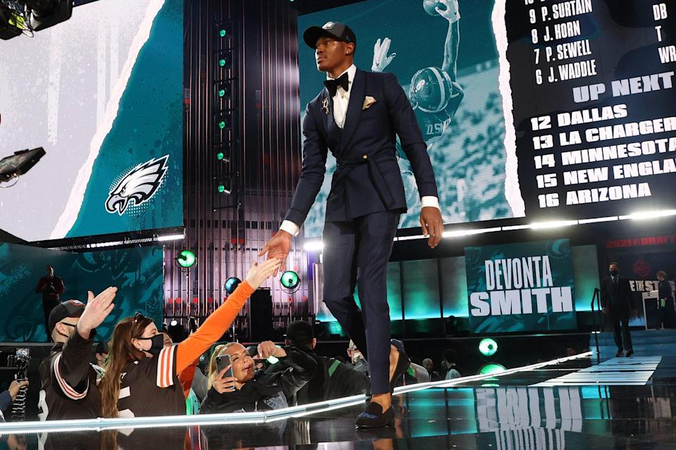 <p>DeVonta Smith shook fans' hands as he walked onstage in Cleveland after being named the 10th pick by the Philadelphia Eagles.</p>
