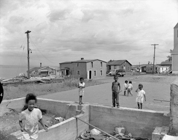 Children playing the in Africville neighbourhood of Halifax in 1958. Photo from Library and Archives Canada
