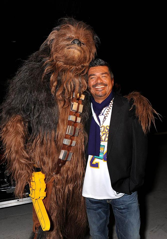 "Talk show host George Lopez got up close and personal with Chewbacca. Jordan Strauss/<a href=""http://www.wireimage.com"" target=""new"">WireImage.com</a> - February 21, 2011"