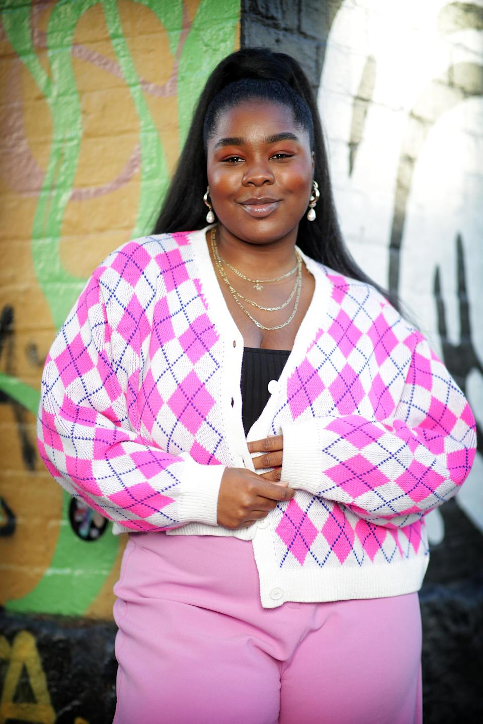Lillian Ahenkan, also know as DJ Flex Mami poses during a photo shoot in Sydney, New South Wales