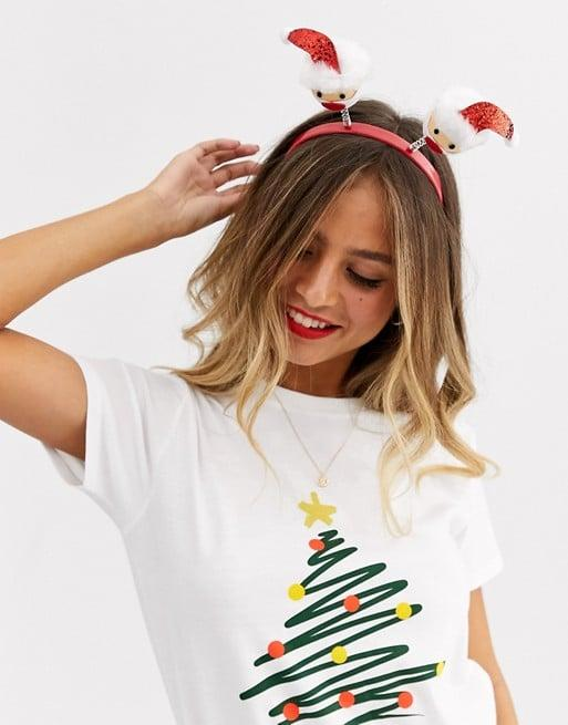 "<p>They can wear this <a href=""https://www.popsugar.com/buy/ASOS-Design-Holidays-Headband-Santa-Claus-Boppers-517752?p_name=ASOS%20Design%20Holidays%20Headband%20With%20Santa%20Claus%20Boppers&retailer=asos.com&pid=517752&price=10&evar1=fab%3Aus&evar9=44259160&evar98=https%3A%2F%2Fwww.popsugar.com%2Ffashion%2Fphoto-gallery%2F44259160%2Fimage%2F46901608%2FASOS-Design-Holidays-Headband-With-Santa-Claus-Boppers&list1=shopping%2Cgifts%2Caccessories%2Choliday%2Cstocking%20stuffers%2Cgift%20guide%2Casos%2Cgifts%20under%20%2425%2Cfashion%20gifts%2Cgifts%20for%20women%2Cgifts%20under%20%24100%2Cgifts%20under%20%2450%2Cgifts%20under%20%2475&prop13=mobile&pdata=1"" rel=""nofollow"" data-shoppable-link=""1"" target=""_blank"" class=""ga-track"" data-ga-category=""Related"" data-ga-label=""https://www.asos.com/us/asos-design/asos-design-holidays-headband-with-santa-claus-boppers/prd/12808819?clr=red&amp;colourWayId=16523403&amp;SearchQuery=&amp;cid=27360"" data-ga-action=""In-Line Links"">ASOS Design Holidays Headband With Santa Claus Boppers</a> ($10) to any party of the season.</p>"