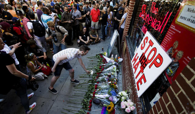 <p>People gather for a vigil for the victims of a mass shooting at an Orlando, Fla., gay club outside of the Stonewall Inn, a famous gay bar, in New York City, June 12, 2016. (EPA/Justin Lane) </p>