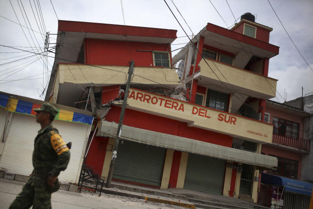 <p>A soldier walks by a partially collapsed structure in the town of Matias Romero, Oaxaca state, Mexico, Friday, Sept. 8, 2017. (Photo: Felix Marquez/AP) </p>