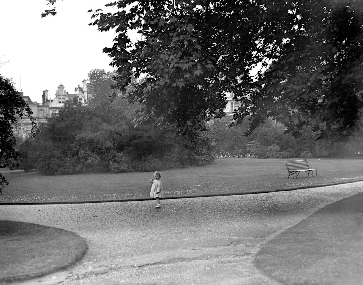 <p>Princess Elizabeth at play in her garden in Piccadilly (PA Archive) </p>