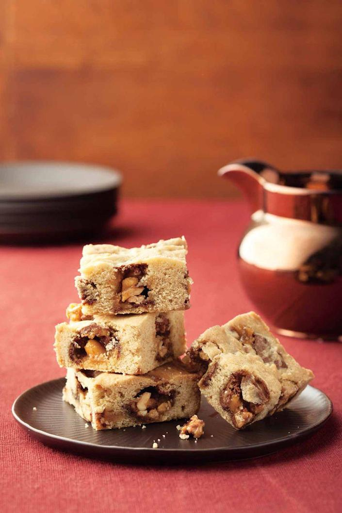 """<p>This bake sale favorite gets an upgrade with bits of Snickers, which you can swap out with any other chocolate candy bars you like, such as Milky Way or Reese's Pieces. You can also go the traditional route and use chocolate chips and pecans instead.<br></p><p><a href=""""https://www.womansday.com/food-recipes/food-drinks/recipes/a11859/snickers-blondies-recipe-123648/"""" rel=""""nofollow noopener"""" target=""""_blank"""" data-ylk=""""slk:Get the recipe for Snickers Blondies."""" class=""""link rapid-noclick-resp""""><u><em>Get the recipe for Snickers Blondies.</em></u></a></p>"""