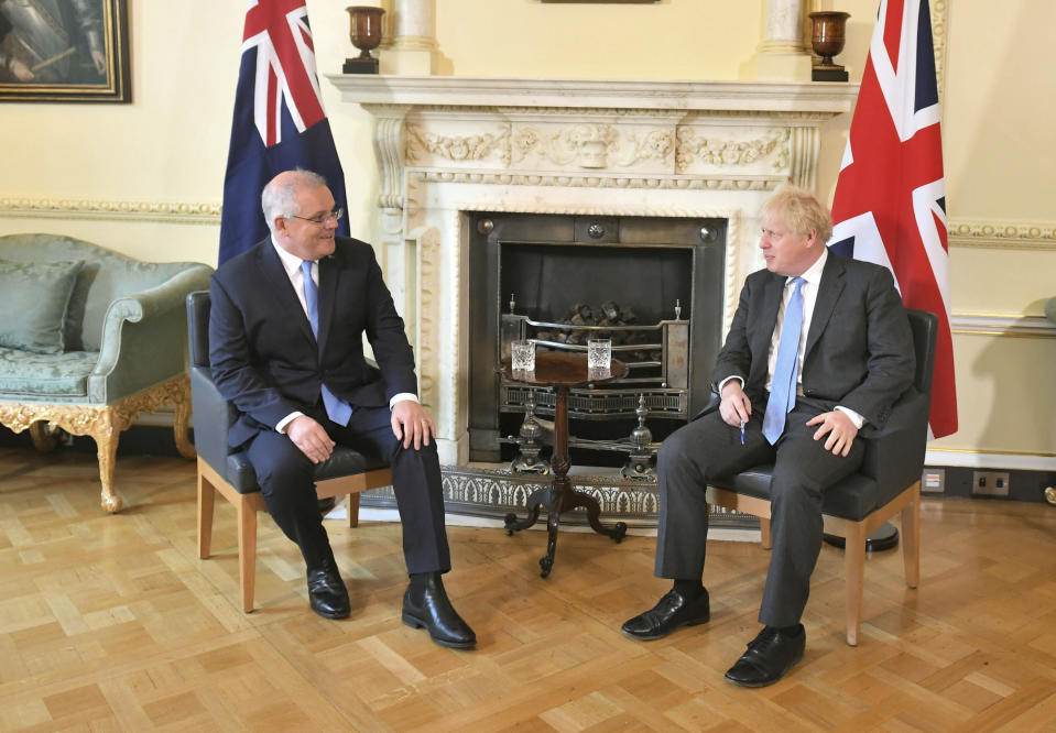 Britain's Prime Minister Boris Johnson, right, poses for a photo with Australian Prime Minister Scott Morrison, ahead of their meeting, at 10 Downing Streeet, in London, Tuesday June 15, 2021. Britain and Australia have agreed on a free trade deal that will be released later Tuesday, Australian Trade Minister Dan Tehan said. (Dominic Lipinski/Pool Photo via AP)