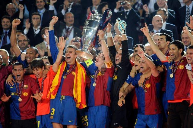Barcelona's Carles Puyol lifts the Champions League trophy following victory over Manchester United in 2009