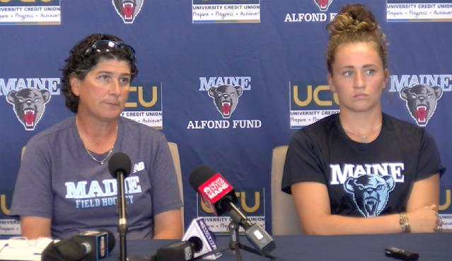 University of Maine field hockey head coach Josette Babineau, left, and senior team captain Riley Field are shown during a press conference on Monday, Sept. 9, 2019, in Orono, Maine. After the shock wore off of halting a women's field hockey game in the middle of overtime just so they could shoot off fireworks for a football game that hadn't even started, the captain of the Maine team said it's par for the course when you're a female athlete. Indeed, for all the advances created by Title IX, there's still an awful lot of hearts and minds that still need changing. (University of Maine Athletics via AP)