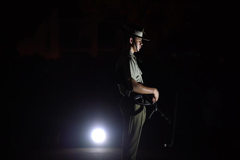 A member of the Catafalque party during Anzac Day Dawn services at Anzac Memorial Park in Townsville. Source: AAP