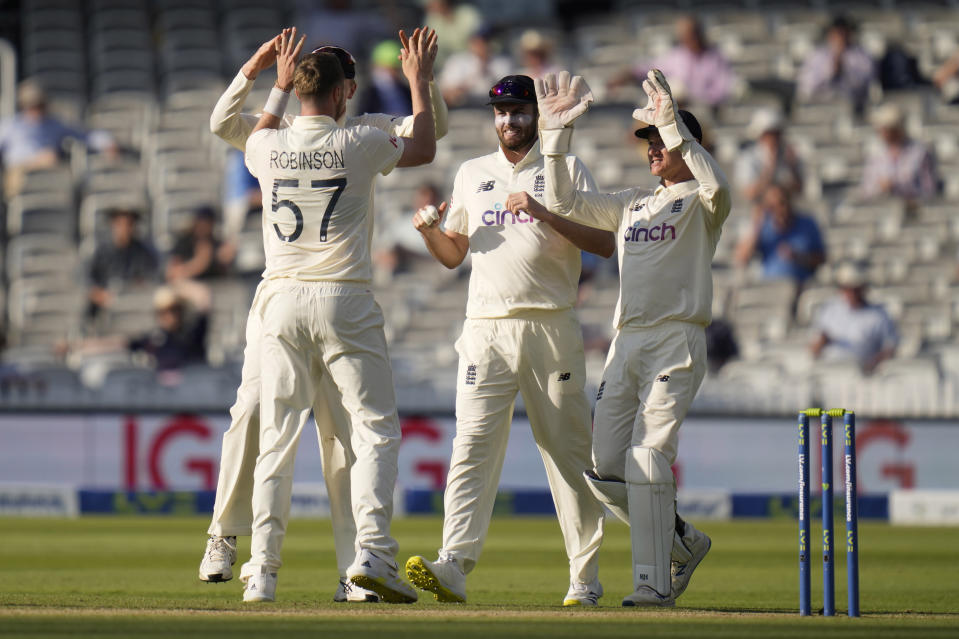England's Ollie Robinson celebrates taking the wicket of New Zealand's Kane Williamson during the fourth day of the Test match between England and New Zealand at Lord's cricket ground in London, Saturday, June 5, 2021. (AP Photo/Kirsty Wigglesworth)