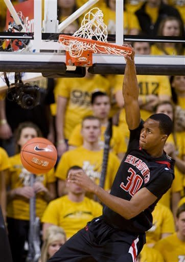 Texas Tech's Jaye Crockett dunks the ball during the second half of an NCAA college basketball game against Missouri Saturday, Jan. 28, 2012, in Columbia, Mo. Missouri won the game 63-50. (AP Photo/L.G. Patterson)