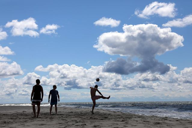 German fans play soccer at the beach in Yantarny, Kaliningrad, Russia, June 23, 2018. As well as shooting all the matches, Reuters photographers are producing pictures showing their own quirky view from the sidelines of the World Cup. REUTERS/Mariana Bazo