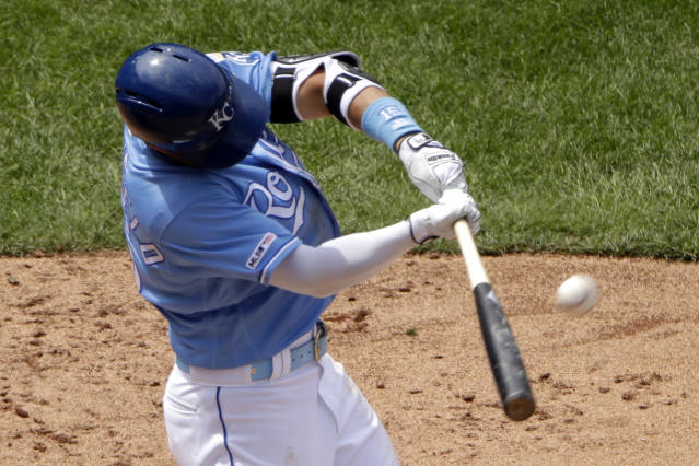 Kansas City Royals' Whit Merrifield hits a three-run home run during the sixth inning of the first baseball game in a doubleheader against the New York Yankees, Saturday, May 25, 2019, in Kansas City, Mo. (AP Photo/Charlie Riedel)