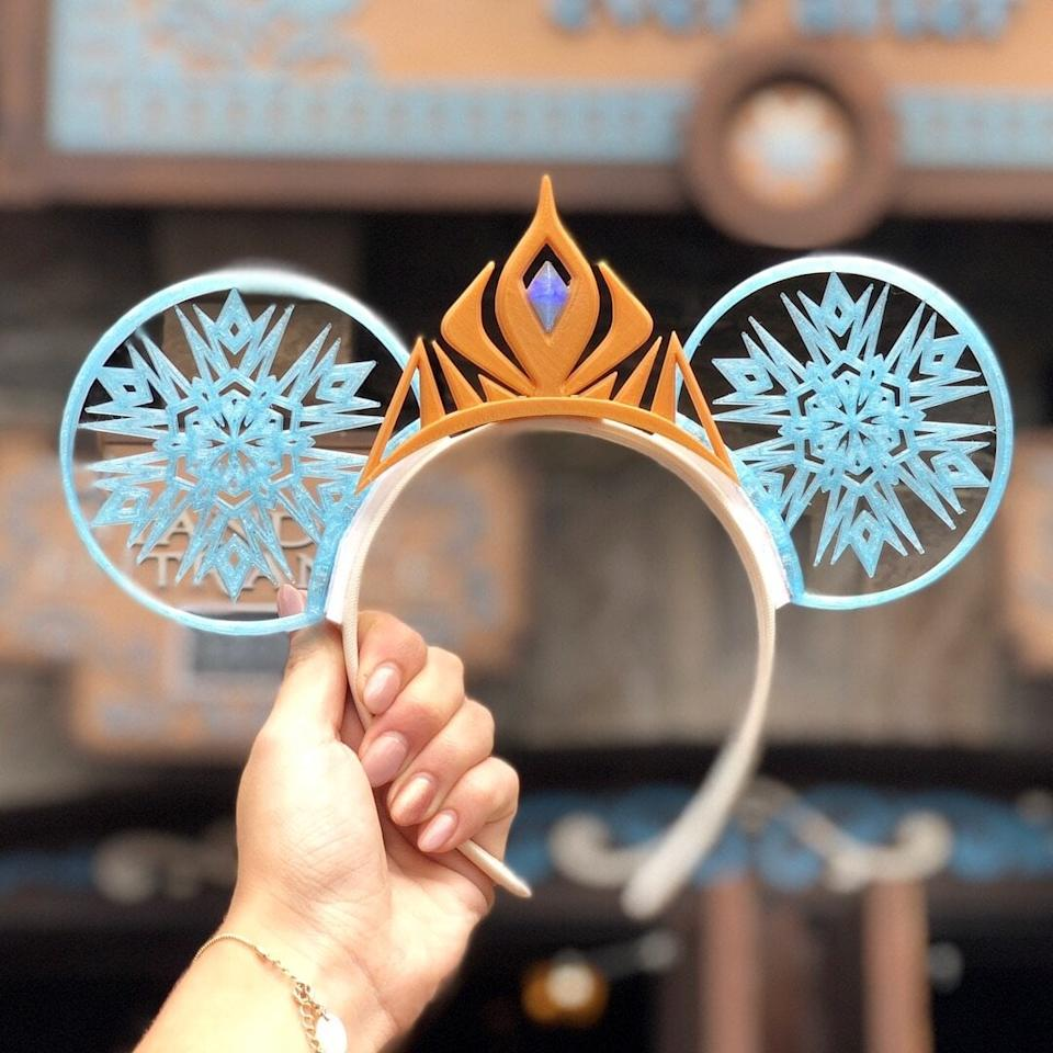 """<p>Being an ice queen isn't such a bad thing if you get to wear these <a href=""""https://www.popsugar.com/buy/Standard-Ice-Queen-Ears-479531?p_name=Standard%20Ice%20Queen%20Ears&retailer=imaginexears.com&pid=479531&price=45&evar1=savvy%3Aus&evar9=46495745&evar98=https%3A%2F%2Fwww.popsugar.com%2Fphoto-gallery%2F46495745%2Fimage%2F46495748%2FStandard-Ice-Queen-Ears&list1=disney%2Cmickey%20ears&prop13=api&pdata=1"""" rel=""""nofollow"""" data-shoppable-link=""""1"""" target=""""_blank"""" class=""""ga-track"""" data-ga-category=""""Related"""" data-ga-label=""""http://imaginexears.com/collections/princess-collection/products/ice-queen-with-3d-printed-tiara"""" data-ga-action=""""In-Line Links"""">Standard Ice Queen Ears</a> ($45 with bow or $60 with tiara), right? </p>"""
