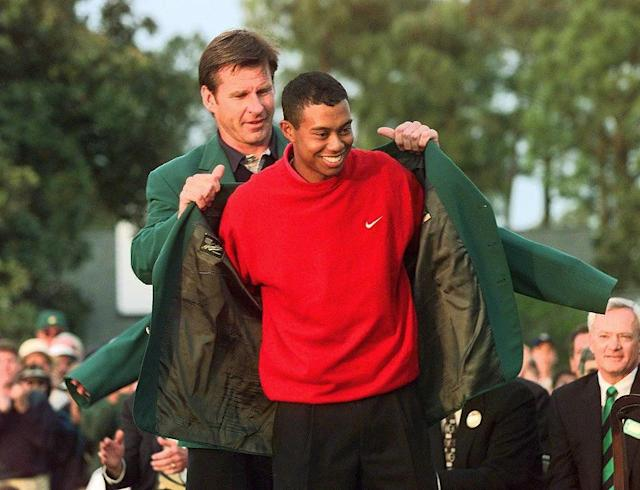 Tiger Woods receives the Masters green jacket after winning the 1997 Masters Tournament April 13,1997 at Augusta National Golf Club in Georgia (AFP Photo/Jeff Haynes)