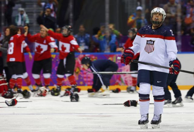Team USA's Lee Stecklein skates away as Canada celebrates winning their women's ice hockey gold medal game at the Sochi 2014 Winter Olympic Games