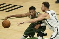 Milwaukee Bucks' Giannis Antetokounmpo tries to get past Brooklyn Nets' Blake Griffin during the first half of Game 3 of the NBA Eastern Conference basketball semifinals game Thursday, June 10, 2021, in Milwaukee. (AP Photo/Morry Gash)