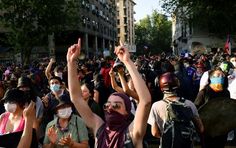 Demonstrators shout slogans during a protest against the government in Santiago on Monday