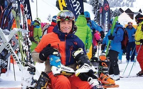 Martin Bell surrounded by ski boots at the ski test in Kuhtai - Credit: ADRIAN MYERS