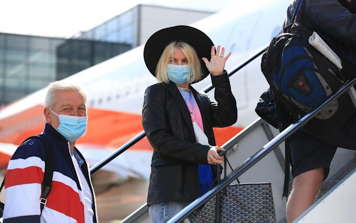 Passengers prepare to board an easyJet flight to Faro, Portugal, at Gatwick Airport in West Sussex after the ban on international leisure travel for people in England was lifted - Gareth Fuller/PA