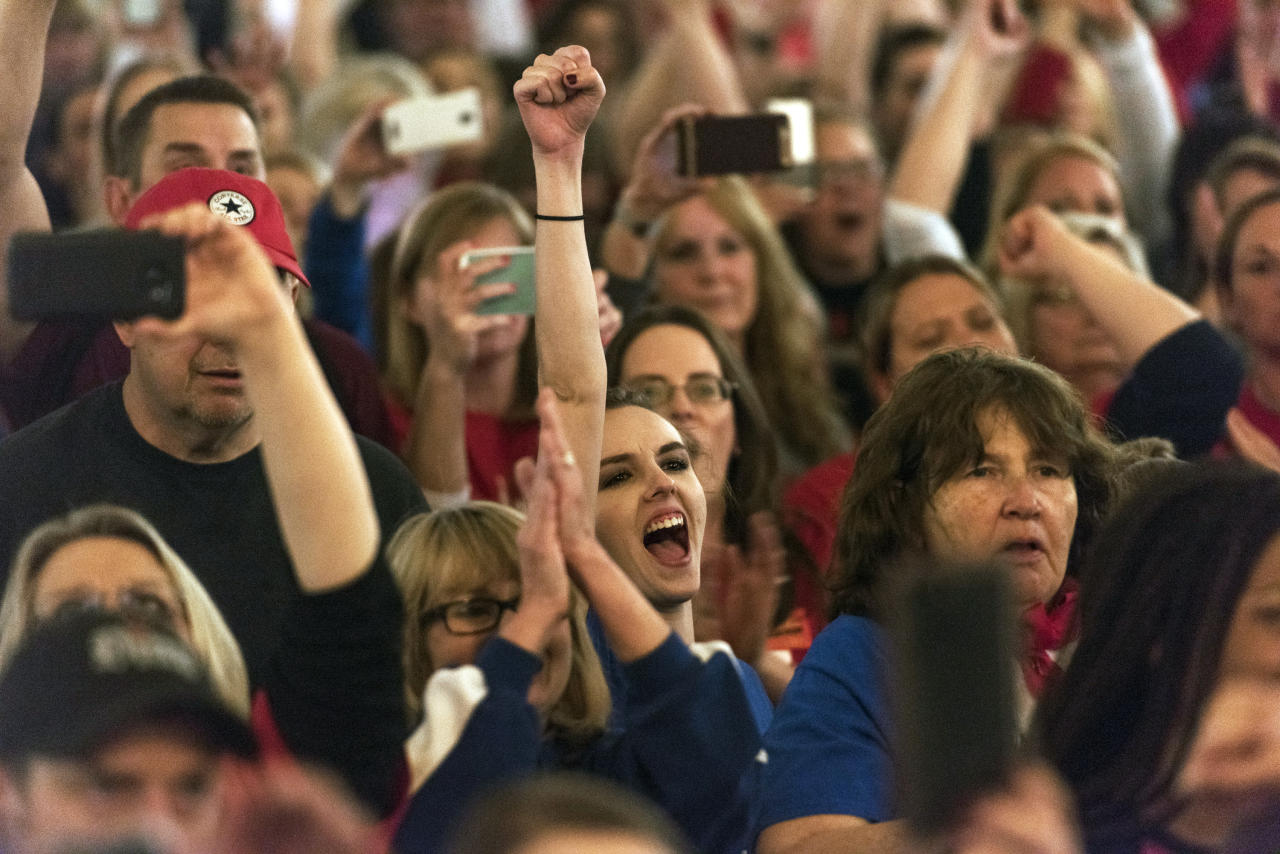 <p>Teachers and school personnel celebrate after the state Senate approved a bill to increase state employee pay by 5 percent at the capitol in Charleston, W.Va., on Tuesday, March 6, 2018. The lawmakers unanimously approved the pay raises for teachers and troopers, after the governor reached a deal to end a teacher walkout that shuttered the state's schools for nine days. (Photo: Craig Hudson/Charleston Gazette-Mail via AP) </p>