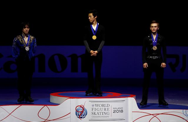 Figure Skating - World Figure Skating Championships - The Mediolanum Forum, Milan, Italy - March 24, 2018 Nathan Chen of the U.S. poses with the gold medal as Japan's Shoma Uno and Russia's Mikhail Kolyada pose with their silver and bronze medals after the Men's Free Skating REUTERS/Alessandro Garofalo