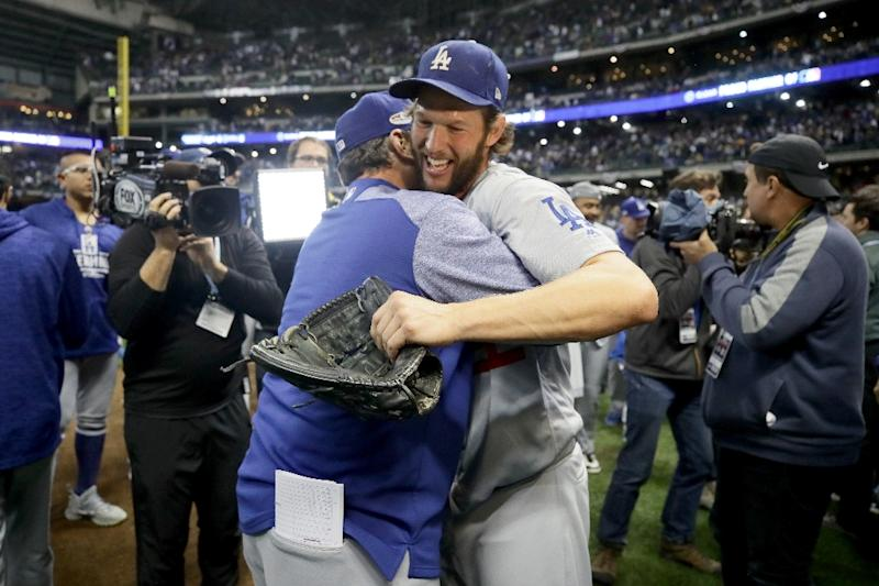 Pitcher Clayton Kershaw celebrates after the Dodgers clinch a 2018 World Series showdown with the Boston Red Sox (AFP Photo/JONATHAN DANIEL)