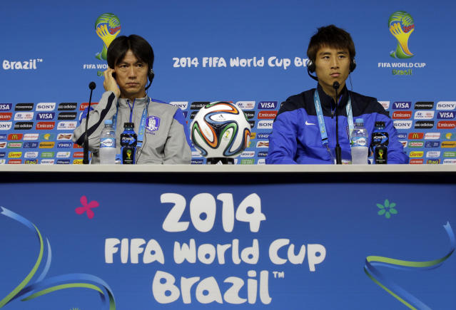 South Korea national soccer team coach Hong Myung-bo, left, and team captain Koo Ja-cheol listen to reporter's question during a press conference the day before the group H World Cup soccer match between South Korea and Belgium at the Itaquerao Stadium in Sao Paulo, Brazil, Wednesday, June 25, 2014. (AP Photo/Lee Jin-man)