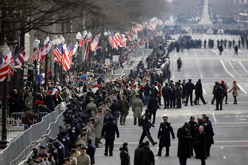 Security lines Pennsylvania Avenue in Washington, Monday, Jan. 21, 2013, prior to the start of the 57th Presidential Inaugural Parade which will take place following President Barack Obama's ceremonial swearing-in on Capitol Hill. (AP Photo/Alex Brandon)