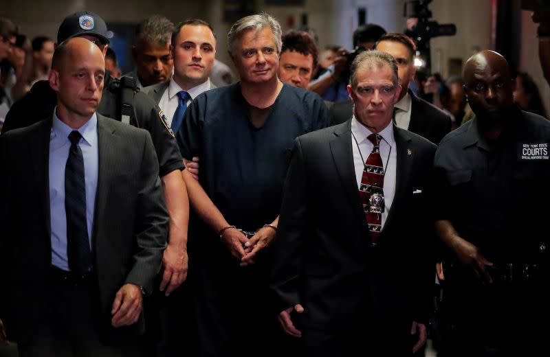 FILE PHOTO: Former Trump campaign chairman Paul Manafort, is escorted into court for his arraignment in New York Supreme Court in New York