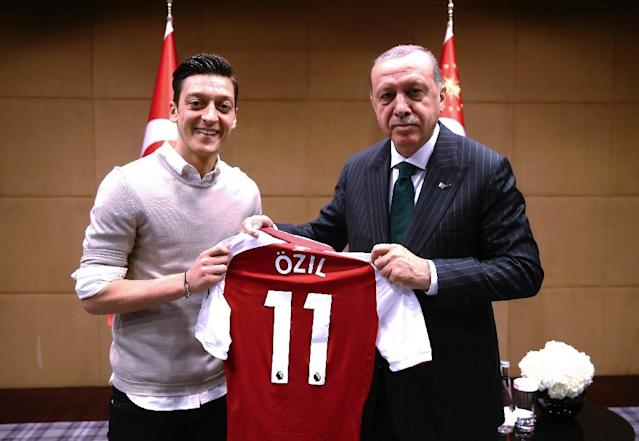 This photograph of Mesut Ozil meeting Turkish President Recep Tayyip Erdogan in May 2018 sparked a storm of criticism in Germany (AFP Photo/KAYHAN OZER)