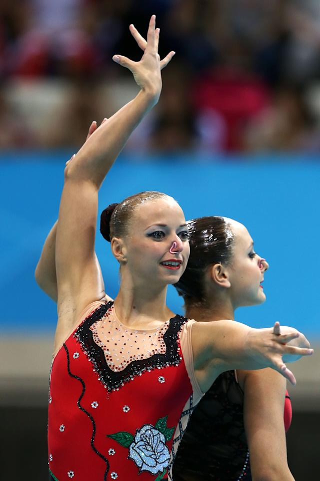 Nadine Brandl and Livia Lang of Austria compete compete in the Women's Duets Synchronised Swimming Technical Routine on Day 9 of the London 2012 Olympic Games at the Aquatics Centre  on August 5, 2012 in London, England.  (Photo by Clive Rose/Getty Images)
