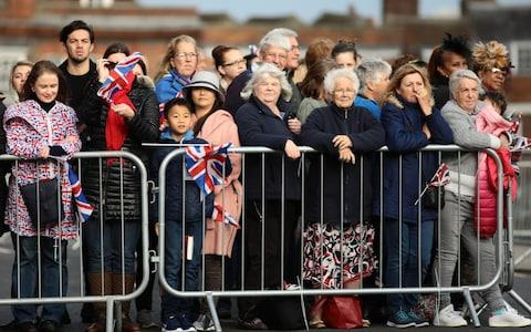 Crowds gathered in Windsor for the royal wedding - Credit: Getty