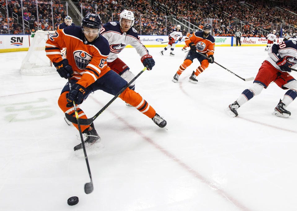 FILE - In this March 7, 2020, file photo, Columbus Blue Jackets center Riley Nash (20) chases Edmonton Oilers' Caleb Jones (82) during the third period of an NHL hockey game in Edmonton, Alberta. The Chicago Blackhawks have traded two-time Norris Trophy winner Duncan Keith to the Oilers for young defenseman Jones and a conditional 2022 third-round draft pick. (Jason Franson/The Canadian Press via AP, File)