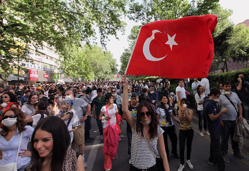 """Young Turks walk during a protest in Ankara, Turkey, Sunday, June 2, 2013. Turkey's prime minister Recep Tayyip Erdogan on Sunday rejected claims that he is a """"dictator,"""" dismissing protesters as an extremist fringe, even as thousands returned to the landmark Istanbul square that has become the site of the fiercest anti-government outburst in years. (AP Photo/Burhan Ozbilici)"""