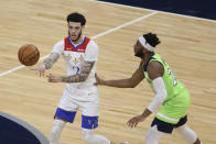 New Orleans Pelicans' Lonzo Ball (2) passes the ball away from Minnesota Timberwolves' Josh Okogie (20) during the first half of an NBA basketball game Saturday, May 1, 2021, in Minneapolis. (AP Photo/Stacy Bengs)