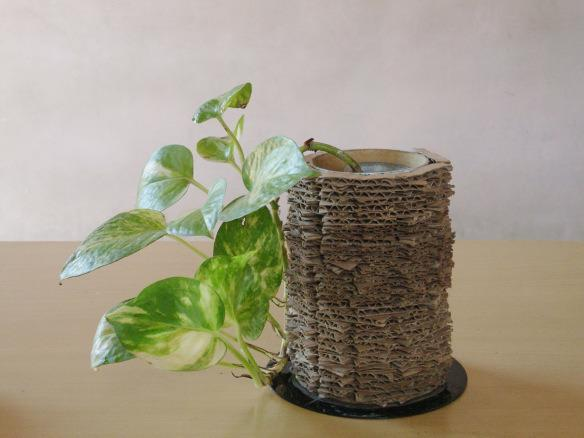 """<p>Here's one that really packs a punch: Make a vase or centerpiece and upcycle a few old items at once. The idea found <a href=""""http://madebylakshmi.com/2013/06/11/recycled-cardboard-vase/"""" rel=""""nofollow noopener"""" target=""""_blank"""" data-ylk=""""slk:here"""" class=""""link rapid-noclick-resp"""">here</a> uses cardboard pieces, an old CD and a cardboard tube to create an earthy-looking piece. Make one, or make a bunch and display them together. (Photo: <a href=""""http://madebylakshmi.com/2013/06/11/recycled-cardboard-vase/"""" rel=""""nofollow noopener"""" target=""""_blank"""" data-ylk=""""slk:M@de by Lakshmi"""" class=""""link rapid-noclick-resp"""">M@de by Lakshmi</a>)</p>"""