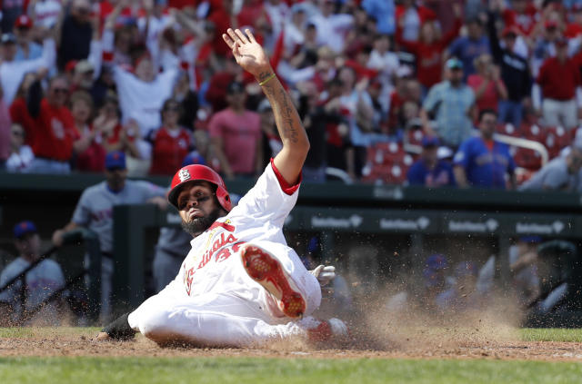 St. Louis Cardinals' Jose Martinez scores the winning run during the 13th inning of a baseball game against the New York Mets, Thursday, April 26, 2018, in St. Louis. (AP Photo/Jeff Roberson)