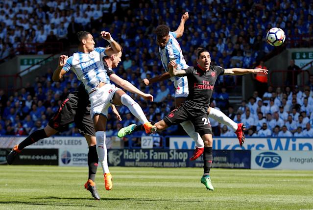 "Soccer Football - Premier League - Huddersfield Town vs Arsenal - John Smith's Stadium, Huddersfield, Britain - May 13, 2018 Huddersfield Town's Steve Mounie and Tom Ince in action with Arsenal's Granit Xhaka and Hector Bellerin Action Images via Reuters/Andrew Boyers EDITORIAL USE ONLY. No use with unauthorized audio, video, data, fixture lists, club/league logos or ""live"" services. Online in-match use limited to 75 images, no video emulation. No use in betting, games or single club/league/player publications. Please contact your account representative for further details. TPX IMAGES OF THE DAY"