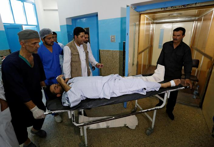 <p>An injured man is carried inside a hospital after a suicide attack in Kabul, Afghanistan, Aug. 29, 2017. (Photo: Mohammad Ismail/Reuters) </p>