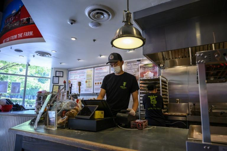 Togi, 16, started working in a fast food restaurant after his father lost his job during the Covid-19 pandemic