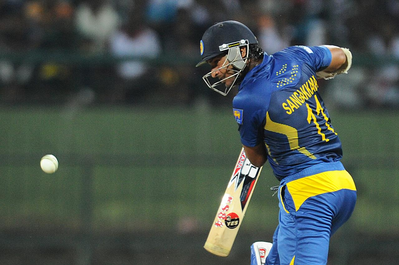 Sri Lankan batsman Kumar Sangakkara plays a shot during the fourth One Day International (ODI) cricket match between Sri Lanka and South Africa at the Pallekele International Cricket Stadium in Pallekele on July 28, 2013. AFP PHOTO/ Ishara S.KODIKARA