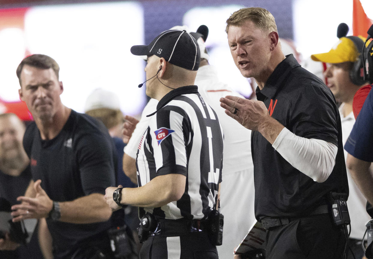 Nebraska coach Scott Frost protests a delay of game penalty for use of illegal signals, during the first half of the team's NCAA college football game against Michigan on Saturday, Oct. 9, 2021, in Lincoln, Neb. (AP Photo/Rebecca S. Gratz)