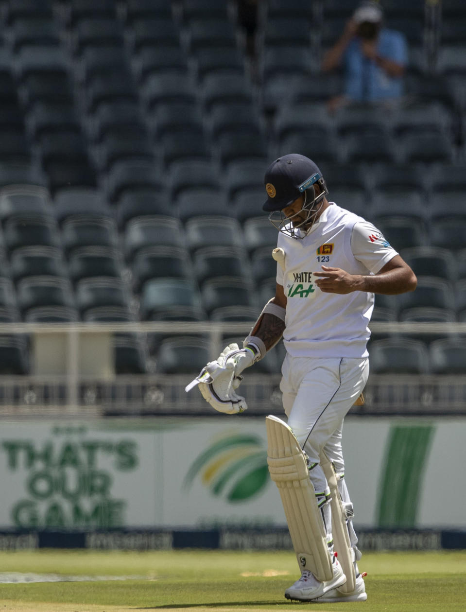 Sri Lanka's captain Dimuth Karunaratne leaves the field after being dismissed by South Africa's bowler Anrich Nortje during the 2nd Test cricket match between South Africa and Sri Lanka in Johannesburg, South Africa, Sunday, Jan. 3, 2021. (AP Photo/Themba Hadebe)[
