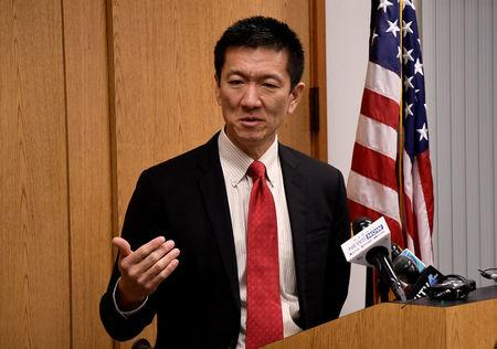 Hawaii Attorney General Douglas Chin speaks at a press conference after filing an amended lawsuit against President Donald Trump's new travel ban in Honolulu, Hawaii, March 9, 2017. REUTERS/Hugh Gentry