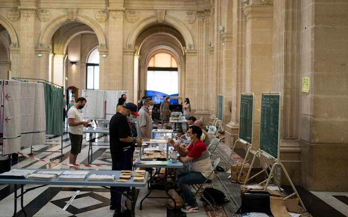 French voters cast their ballots during regional elections in Marseille - AP